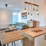 Obývací pokoj s kuchyňskou linkou apartmánu A1